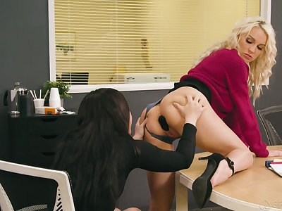 Two lesbian colleagues try anal sex not susceptible the table in the office