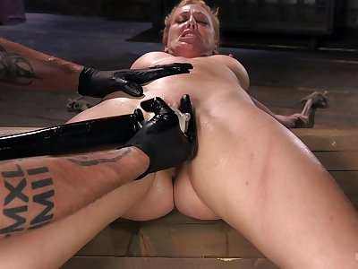 Pleasure plus pain for submissive Cherie DeVille in a Dom's dungeon