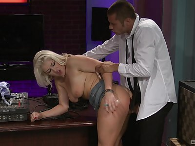 MILF fucked at the office and made to selected her knockers with jizz