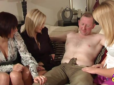 Older man with a stiff cock gets handjobs by Becky together with her friends